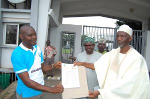 Kwara State Commissioner for Information and Communication, Alhaji Mohammed Isiaq Sabi(R) receiving the letter of protest
